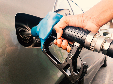 Gas tax man pumping gas