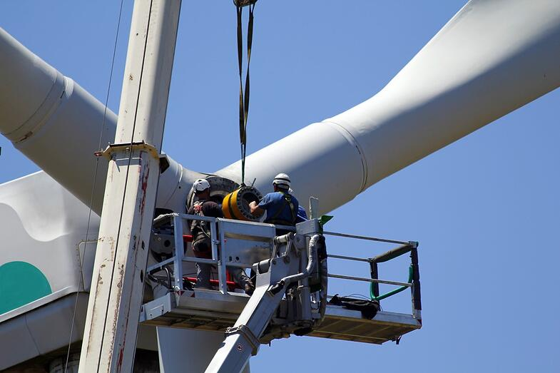 Two workers assembling wind turbine with ERAD Torque Wrench