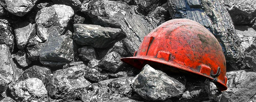 Pile of Coal with a dirty Work hat. Coal war is over.