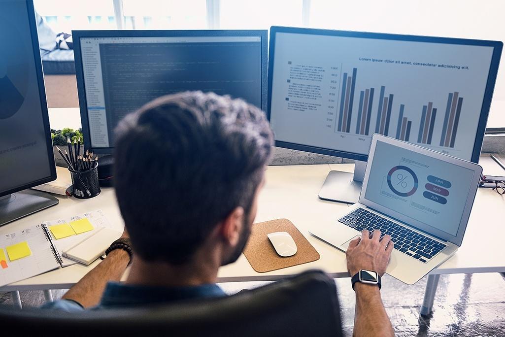 Engineer at computer reading data.